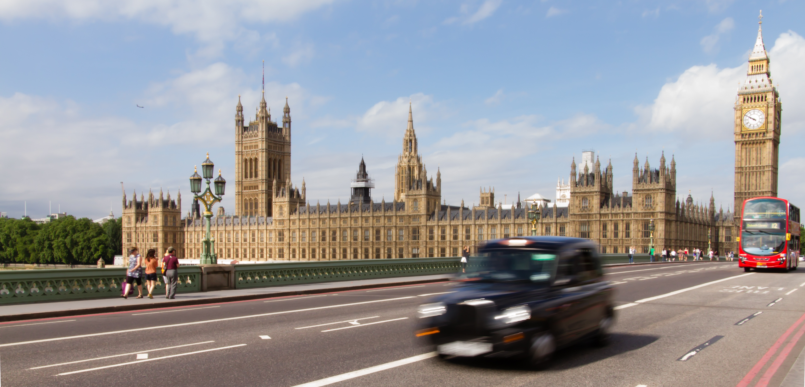 Westminster bridge with black cab and red bus